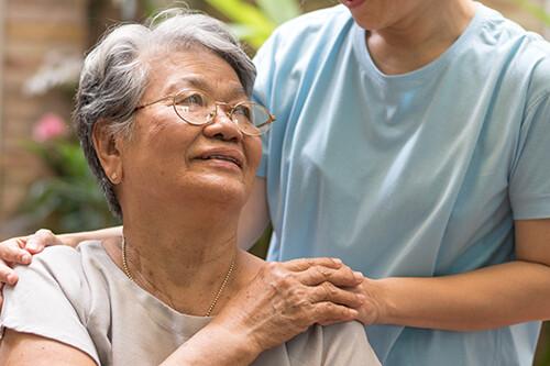 Caregiver, carer hand holding elder hand woman.